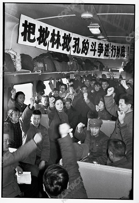 "Attendants on a train traveling from Qiqihar to Beijing organize passengers to participate in the ""anti-Lin Biao, anti-Confucius"" campaign initiated by Mao's wife, Jiang Qing; Heilongjiang Province, March 15, 1974."