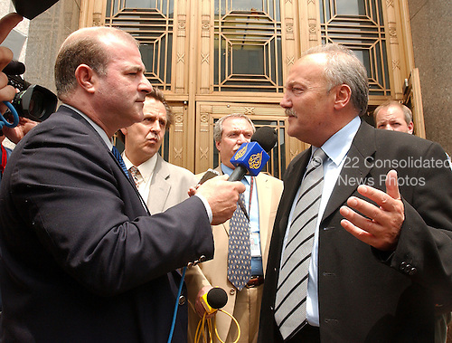 """Washington, D.C. - May 17, 2005 -- George Galloway , Member of Parliament for Bethnal Green and Bow, Great Britain, right, is interviewed by a reporter from al-Jazeera-TV, left, after giving testimony before the United States Senate Committee on Homeland Security and Governmental Affairs Permanent Subcommittee on Investigations hearing on """"Oil For Influence: How Saddam Used Oil to Reward Politicians Under the United Nations Oil-for-Food Program"""" in Washington, D.C. on May 17, 2005.  .Credit: Ron Sachs / CNP"""