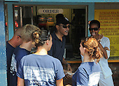 Oak Bluffs, MA - August 26, 2009 -- United States President Barack Obama and his wife Michelle greet employees as they  stop to pick up a a take-out lunch of fried seafood at Nancy's Restaurant in Oak Bluffs, Massachusetts on the island of Martha's Vineyard, Wednesday, August 26, 2009.  .Credit: Neal Hamberg - Pool via CNP