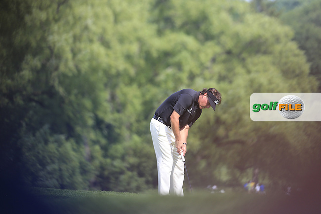 Phil Mickelson (USA) putts on the 9th green during Thursday's Round 1 of the 95th US PGA Championship 2013 held at Oak Hills Country Club, Rochester, New York.<br /> 8th August 2013.<br /> Picture: Eoin Clarke www.golffile.ie