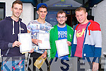 MARKS; Looking over their leaving cert results on Wednesday morning were students of Castleisland Community College, l-r: James Nolan and CJ O'Sullivan (Currow), Richie Cotter (Knocknagoshel) and Scott O'Brien (Ballymacelligott).