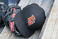 Fresno Grizzlies hat and glove on the dugout steps on June 22, 2014 at the Dell Diamond in Round Rock, Texas. (Andrew Woolley/Four Seam Images)