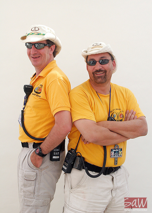 BLACK ROCK CITY,NV - AUGUST 29, 2008:  Marcus Della, right, and David Kovar,left, volunteer their time as Black Rock Emergency services rangers. Della has attended 14 burns, this year is Kovar's 5th. Photographed at center camp, August 29, 2008.