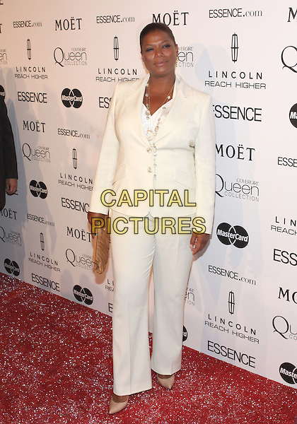 QUEEN LATIFAH.The Third Annual ESSENCE Black Women In Hollywood Luncheon held at The Beverly Hills Hotel in Beverly Hills, California, USA. .March 4th, 2010 .full length white cream suit trousers jacket  beige clutch bag .CAP/ADM/TC.©T. Conrad/AdMedia/Capital Pictures.