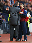 George Burley commiserates with  Macedonian manager Mirsad Jonuz at the end