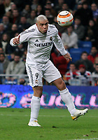 Real Madrid's Ronaldo scores past RCD Espanyol's Daniel Jarque during Spanish La Liga game between Real Madrid and RCD Espanyol at Santiago Bernabeu stadium in Madrid Saturday 04 February, 2006. (Photo Alvaro Hernandez/Insidefoto).