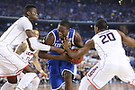 UConn center Amida Brimah (35), UK forward Julius Randle (30) and UConn guard/forward Lasan Kromah (20) fight for the ball during the NCAA Championship vs. UConn at the AT&T Stadium in Arlington, Tx., on Monday, April 7, 2014. Photo by Emily Wuetcher | Staff