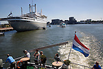 Spido tour boats view the SS Rotterdam former flagship of the Holland-America line now a hotel and tourist attraction, Rotterdam, Netherlands