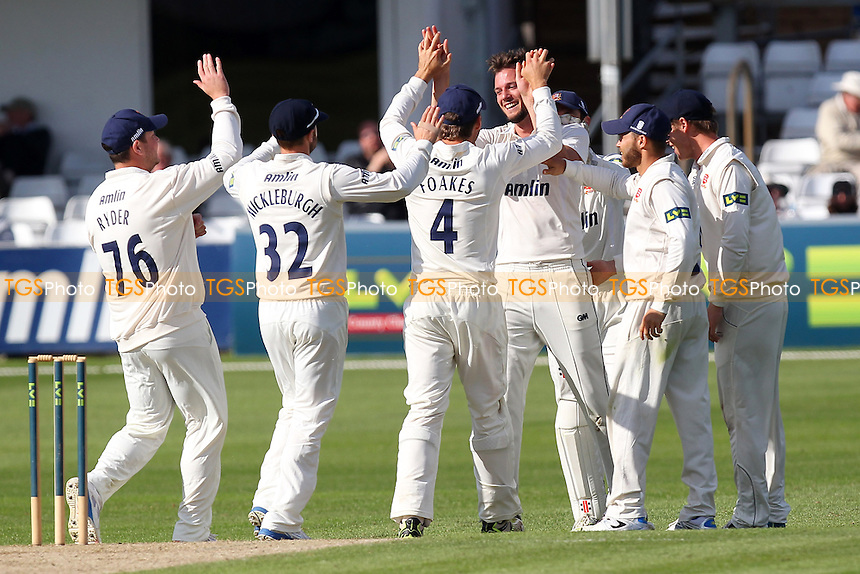 Tom Moore of Essex (C) is congratulated on the wicket of Rory Burns - Essex CCC vs Surrey CCC - LV County Championship Division Two Cricket at the Essex County Ground, Chelmsford, Essex - 25/05/14 - MANDATORY CREDIT: Gavin Ellis/TGSPHOTO - Self billing applies where appropriate - 0845 094 6026 - contact@tgsphoto.co.uk - NO UNPAID USE
