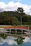 Soribashi, arched bridge reflecting in a pond of Phoenix Hall, Hoodo, Amida Hall of Byodo-in, Byodoin Buddhist temple in Uji, Kyoto Prefecture, Japan 2017