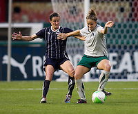 Sarah Huffman (14) of the Washington Freedom fights for the ball with Carolyn Blank (3) of the Saint Louis Athletica at RFK Stadium in Washington, DC.  The Washington Freedom defeated Saint Louis Athletica, 3-1.