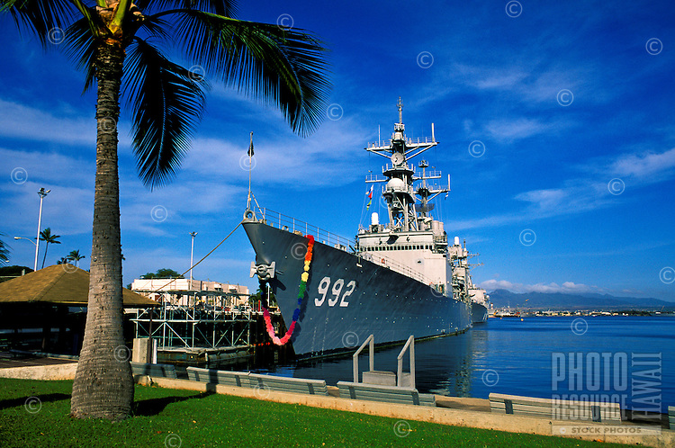 Adorned with a giant flower Lei, this naval vessel is welcomed home from a long tour at sea. Pearl harbor.