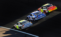 Mar. 1, 2009; Las Vegas, NV, USA; NASCAR Sprint Cup Series drivers Jimmie Johnson (48), Kurt Busch (2) and Jeff Gordon (24) race three wide during the Shelby 427 at Las Vegas Motor Speedway. Mandatory Credit: Mark J. Rebilas-