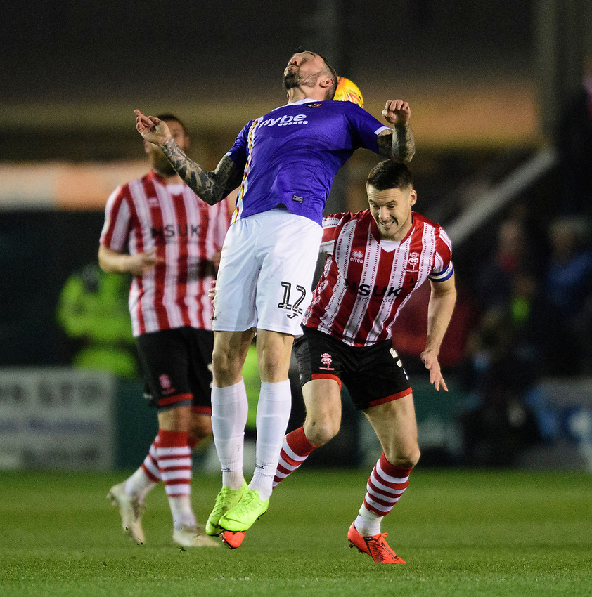 Lincoln City's Jason Shackell vies for possession with Exeter City's Ryan Bowman<br /> <br /> Photographer Chris Vaughan/CameraSport<br /> <br /> The EFL Sky Bet League Two - Lincoln City v Exeter City - Tuesday 26th February 2019 - Sincil Bank - Lincoln<br /> <br /> World Copyright © 2019 CameraSport. All rights reserved. 43 Linden Ave. Countesthorpe. Leicester. England. LE8 5PG - Tel: +44 (0) 116 277 4147 - admin@camerasport.com - www.camerasport.com