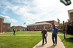 Students walk through the main green of Ohio University Southern.
