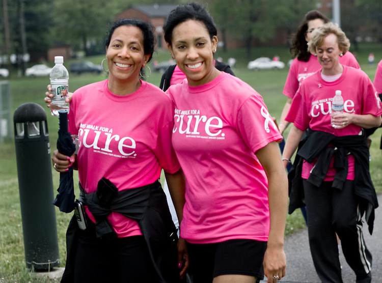 Gaile Ozanne, left, walks with her daughter Monique during the Walk for A Cure Saturday on the Ohio University campus.