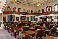 House of Representatives, the largest room in the Texas State Capitol, designed in 1881 by Elijah E Myers and built 1882-88, Austin, Texas, USA. The chamber has been restored to its 1909 appearance, with 150 oak desks by A H Andrews, brown leather armchairs, brass chandeliers and an oak panelled public gallery. The building is in Italian Neo-Renaissance style, with both Corinthian and Doric details and a large central dome. The State Capitol houses the Senate, Governor's Office, House of Representatives and Supreme Court. It is listed on the National Register of Historic Places and is a National Historic Landmark. Picture by Manuel Cohen
