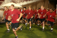 """9 February 2007: Brent Newhouse, Austin Gunder, Tavita Pritchard, Clinton Snyder, T.C. Ostrander, Jim Dray, Fred Campbell and the team during a """"Friday Night Lights"""" practice at Stanford Stadium in Stanford, CA."""