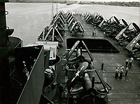 F4U Corsairs and Curtiss SB2C Helldiver planes spotted on the deck of the USS Shangri-La (CV-38) as it goes through the Panama Canal  -  Jan. 24, 1945