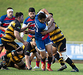 Jonathan Taumatiene looks to break free from Francis Masoe's tackle. Counties Manukau Premier 1 McNamara Cup Final between Ardmore Marist and Bombay, played at Navigation Homes Stadium on Saturday July 20th 2019.<br />  Bombay won the McNamara Cup for the 5th time in 6 years, 33 - 18 after leading 14 - 10 at halftime.<br /> Photo by Richard Spranger.
