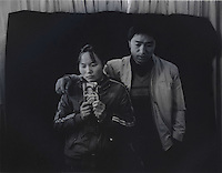 "Mr and Mrs Ma holds a picture of her son Ma Purei, 3 and half years old,  who was stolen  March 22nd  2004.  The message reads, ""Papa and Mama are hoping that you will come home soon.""  Mrs Ha and Mrs Ma is one of thousands of migrant mothers whose children have been stolen and sold to rich families desperate for a boy. Families are limited to a single child under the China's ruthless One Child Policy...PHOTO BY SINOPIX"