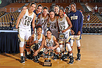 28 November 2010:  FIU's team poses with trophies after the FIU Golden Panthers defeated the Indiana State Sycamores, 68-47, to win the championship game of the 16th annual FIU Thanksgiving Classic at the U.S. Century Bank Arena in Miami, Florida.