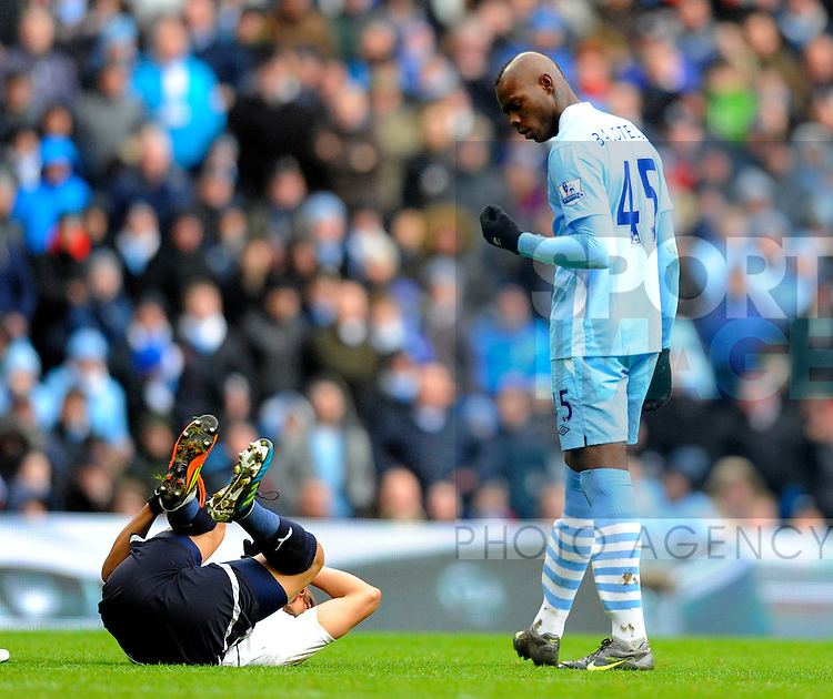 Mario Balotelli of Manchester City gestures to Benoit Assou-Ekotto of Tottenham.Barclays Premier League.Manchester City v Tottenham at the Eithad Stadium, Manchester 22nd January, 2012..Sportimage +44 7980659747.picturedesk@sportimage.co.uk.http://www.sportimage.co.uk/.Editorial use only. Maximum 45 images during a match. No video emulation or promotion as 'live'. No use in games, competitions, merchandise, betting or single club/player services. No use with unofficial audio, video, data, fixtures or club/league logos.