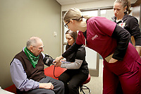 NWA Democrat-Gazette/DAVID GOTTSCHALK Edward VanDuzer (from left) has his blood pressure taken by Kelsie Stanford, student of Physical Therapy, Heather Vaughn, physical therapist, and Sharina Cassity, student of Physical Therapy, Tuesday, February 13, 2018, before a balance and mobility exercise at the University of Arkansas for Medical Sciences Northwest Outpatient Therapy Clinic in Fayetteville. The physical therapy program is new and the first cohort of 24 students is expected to graduate this May.