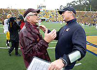 California head coach Jeff Tedford shakes hands with ASU head coach Dennis Erickson after the game at Memorial Stadium in Berkeley, California on October 23rd, 2010.  California defeated Arizona State, 50-17.
