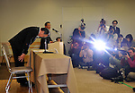 January 18, 2012, Tokyo, Japan - President Shuichi Takayama of scandal-tinted Olympus bows deeply at the end of a news conference in Tokyo on Wednesday, January 18, 2012. Takayama told the news conference that the current leadership, including Takayama himself, would remain in office for another three months as the camera and medical equipment maker prepared for an extraordinary shareholders' meeting in the latter half of April...Olympus set up the news conference a day after the company-appointed independent panel cleared auditing firms from responsibility for the company's accounting scandal but found five current and former individual auditors culpable, which means Olympus won't take legal action against its outside accounting firms for failing to uncover a 13-year effort to hide $1.5 billion in investment losses. (Photo by Natsuki Sakai/AFLO) AYF -mis-.