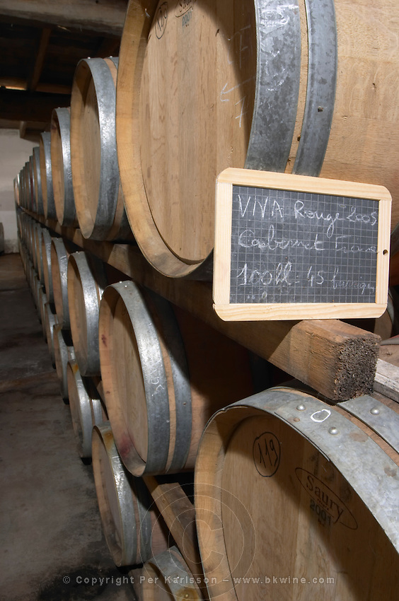 Oak barrel aging and fermentation cellar. Domaine Enclos de la Croix, Languedoc, France