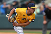 Starting pitcher Jake Lewis (32) of the UNC Greensboro Spartans delivers a pitch in a game against the Furman Paladins in the title game of the Southern Conference Championship series on Sunday, May 28, 2017, at Fluor Field at the West End in Greenville, South Carolina. UNCG won, 13-1. (Tom Priddy/Four Seam Images)