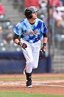 Richmond Flying Squirrels third baseman Ryder Jones (8) runs to first during a game against the Hartford Yard Goats at The Diamond on April 30, 2016 in Richmond, Virginia. The Yard Goats defeated the Flying Squirrels 5-1. (Tony Farlow/Four Seam Images)