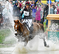 LEXINGTON, KENTUCKY - APRIL 29: Spring Easy #30, with rider Caroline Martin (USA), make a big splash at the Head of the Lake during the Cross Country Test at the Rolex Kentucky 3-Day Event at the Kentucky Horse Park on April 29, 2017 in Lexington, Kentucky. (Photo by Scott Serio/Eclipse Sportswire/Getty Images)