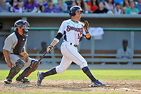 Tennessee shortstop Logan Watkins #14 swings at a pitch during a game against the Huntsville Stars at Smokies Park on August 12, 2012 in Kodak, Tennessee. The Smokies defeated the Stars 4-0. (Tony Farlow/Four Seam Images).