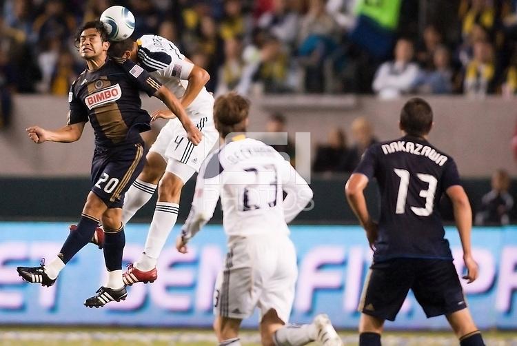 Philadelphia Union forward Carlos Ruiz (20) goes head to head with LA Galaxy defender Omar Gonzalez (4). The LA Galaxy defeated the Philadelphia Union 1-0 at Home Depot Center stadium in Carson, California on  April  2, 2011....