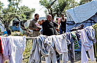 Pictured: A man works out amongs laundry.<br /> Re: Everyday life at the Moria refugee camp on the island of Lesbos, Greece.