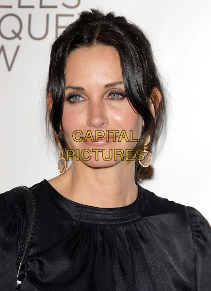 COURTENEY COX ARQUETTE.at the 15th Annual L.A. Antiques Show 2010 held at Barkar Hangar in Santa Monica, California, USA, .April 21st, 2010..portrait headshot hair up black earrings make-up gold dangly                                                                    CAP/RKE/DVS.©DVS/RockinExposures/Capital Pictures