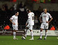 Pictured: (L-R) Leon Britton, Gorka Pintado and Darren Pratley of Swansea City in action <br />