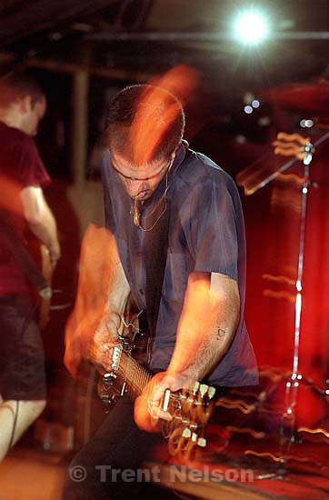 Fugazi, with Ian MacKaye (left) and Guy Picciotto, performing at the Speedway Cafe in Salt Lake City, Utah, June 1990.