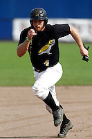 10 September 2011: Bas Nooij of L&D Amsterdam Pirates runs toward third base during game 4 of the 2011 Holland Series won 6-2 by L&D Amsterdam Pirates over Vaessen Pioniers, in Amsterdam, Netherlands.