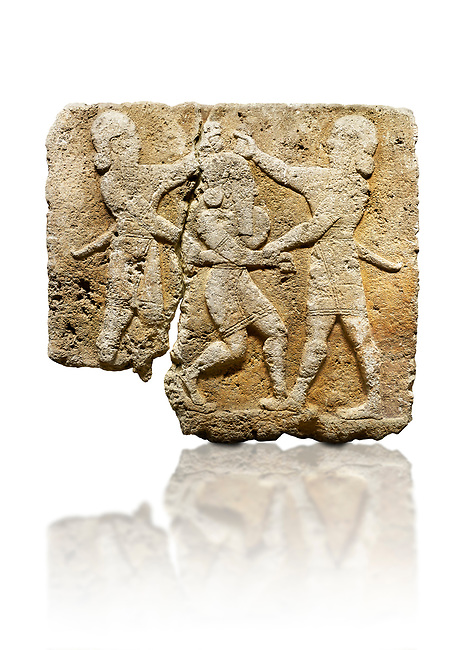 Picture & image of Hittite relief sculpted orthostat stone panel of Herald's Wall Limestone, Karkamıs, (Kargamıs), Carchemish (Karkemish), 900-700 B.C. Anatolian Civilisations Museum, Ankara, Turkey.<br /> <br /> This relief tells the story the killing of Humbaba, protective deity of the cedar forests, by Gilgamesh and Enkidu. The figures standing on both sides hold, with one hand, the arms of the figure in the middle transversally while they stab the dagger on the head of the figure.  <br /> <br /> Against a white background.
