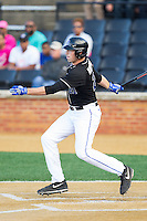 Chris Marconcini (21) of the Duke Blue Devils follows through on his swing against the Wake Forest Demon Deacons at Wake Forest Baseball Park on April 25, 2014 in Winston-Salem, North Carolina.  The Blue Devils defeated the Demon Deacons 5-2.  (Brian Westerholt/Four Seam Images)