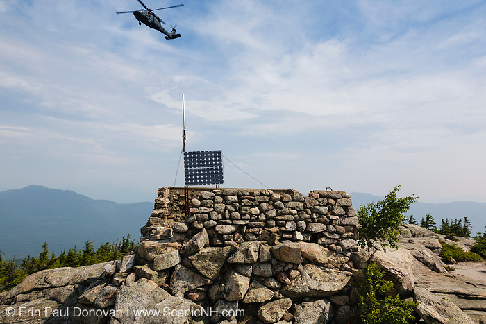 Search and Rescue Helicopter flying over the Middle Sister Trail in hazy weather near Mount Chocorua in the White Mountains, New Hampshire.