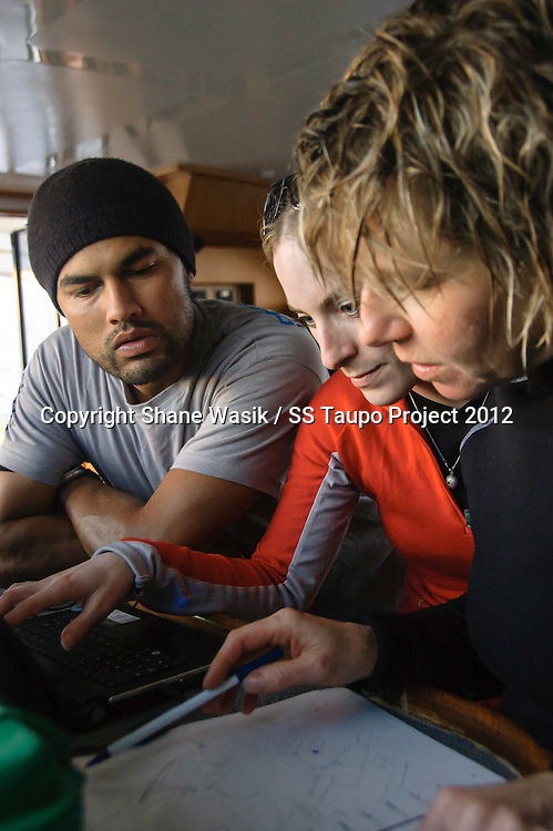 Survey team interpreting data following a dive on the SS Taupo (Photo by Shane Wasik Photography)
