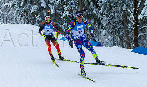 05.03.2016. Oslo Holmenkollen, Oslo, Norway. IBU Biathlon World Championships. L-R  Michael Roesch of Belgium,  Quentin Fillon Maillet of France competes in the men 10km sprint competition during the IBU World Championships Biathlon in Holmenkollen Oslo, Norway.