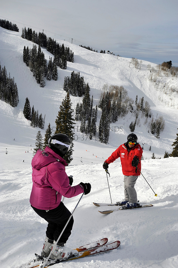 Joe Nevins instructs Shireen Day, 47, of Boulder, CO, as she makes practice turns down Sunrise/Sunset on Aspen Mountain. Michael Brands for The New York Times.