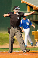 Home plate umpire Travis Godec calls a batter out on strikes during the Appalachian League game between the Pulaski Mariners and the Bluefield Blue Jays at Bowen Field on July 1, 2012 in Bluefield, West Virginia.  The Mariners defeated the Blue Jays 4-3.  (Brian Westerholt/Four Seam Images)