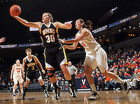 Dec. 18, 2010; Charlottesville, VA, USA; UMBC Retrievers guard Erin Brown (30) grabs the rebound in front of Virginia Cavaliers forward Chelsea Shine (50) during the game at the John Paul Jones Arena. Virginia won 61-46. Mandatory Credit: Andrew Shurtlef
