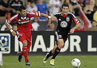 WASHINGTON, DC. - AUGUST 22, 2012:  Chris Pontius (13) of DC United pulls away from  Gonzalo Segares (13) of the Chicago Fire during an MLS match at RFK Stadium, in Washington DC,  on August 22. United won 4-2.